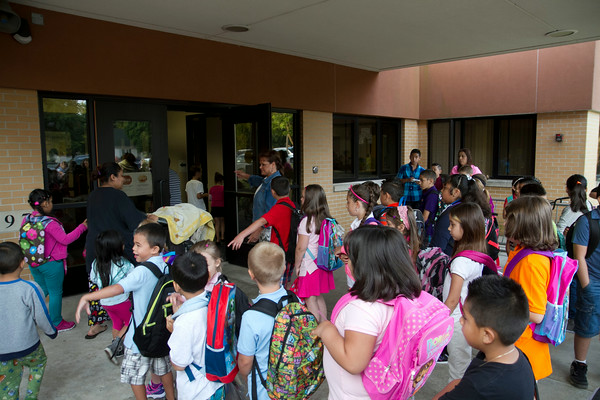 SAM HOUSEHOLDER   THE GOSHEN NEWS<br /> Students line up to go into the school for the first day of class at West Goshen Elementary School Thursday.
