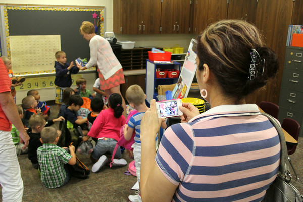 JULIE CROTHERS | THE GOSHEN NEWS<br /> Martha Luz Baea, of Goshen, takes a photo of her son's class on his first day of school Thursday at Parkside Elementary. Her son Larry, 5, is in Cindy Shriener's kindergarten class this year.
