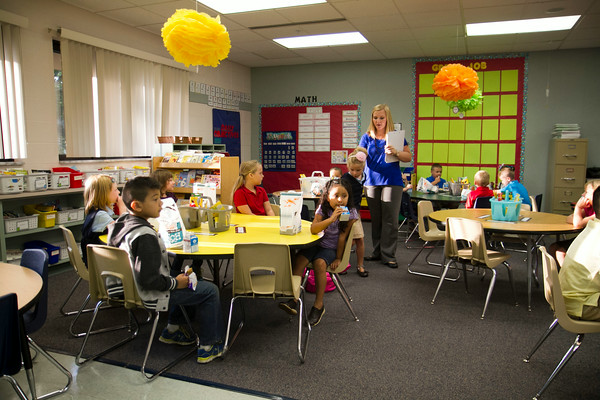 SAM HOUSEHOLDER | THE GOSHEN NEWS<br /> Dana Brown walks through her first grade class Thursday on the first day of school at West Goshen Elementary.