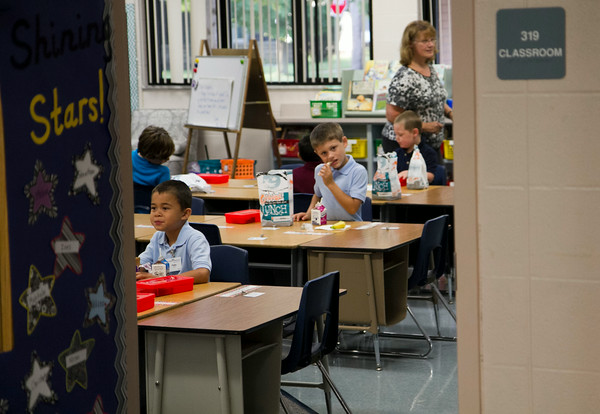 SAM HOUSEHOLDER | THE GOSHEN NEWS<br /> First grade students at West Goshen Elementary School eat breakfast in their classroom Thursday morning.