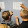 SAM HOUSEHOLDER | THE GOSHEN NEWS<br /> Shawn Pharis, left and Zack Sizemore, both fifth graders, check their class lists Thursday at West Goshen Elementary School. Goshen schools began the 2014-2015 school year Thursday.