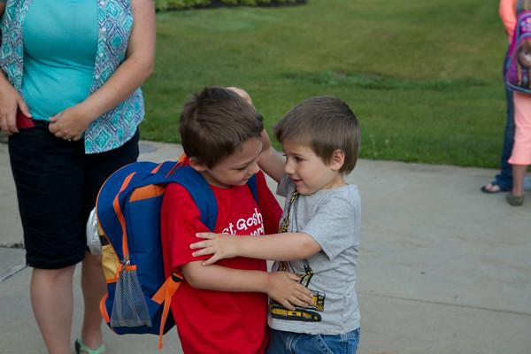 SAM HOUSEHOLDER   THE GOSHEN NEWS<br /> Evan Layne, left, 5, hugs his brother Caleb, 3, before Evan heads to his first day of Kindergarten at West Goshen Elementary School in Goshen.