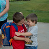 SAM HOUSEHOLDER | THE GOSHEN NEWS<br /> Evan Layne, left, 5, hugs his brother Caleb, 3, before Evan heads to his first day of Kindergarten at West Goshen Elementary School in Goshen.