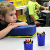 JULIE CROTEHRS | THE GOSHEN NEWS<br /> Kindergartener Riddick Strycker listens closely to his teacher Thursday on the first day of class at Parkside Elementary School.