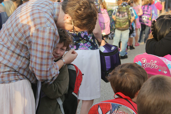 JULIE CROTHERS | THE GOSHEN NEWS<br /> Alistair Eikler, 5, says goodbye to his mom, Carrie Eikler, before joining his classmates for his first day of kindergarten Thursday at Parkside Elementary School.