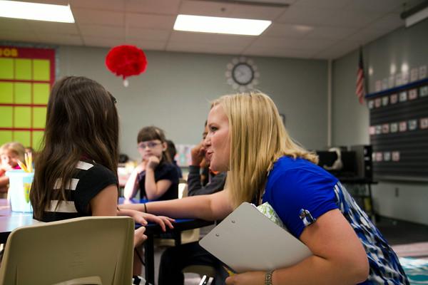 SAM HOUSEHOLDER | THE GOSHEN NEWS<br /> Dana Brown talks with one of her first grade students Thursday at West Goshen Elementary School.