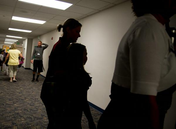 SAM HOUSEHOLDER   THE GOSHEN NEWS<br /> A mother hugs her daughter in the hallway Thursday at West Goshen Elementary School.