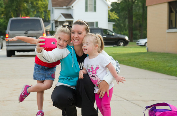 SAM HOUSEHOLDER | THE GOSHEN NEWS<br /> Cassidy Fox, center, takes a selfie with her daughters Jadyn, left who is beginning kindergarten at West Goshen Elementary School, and Kylie, 5, right. Goshen parents sent their children off to school Thursday for the first day of the 2014-2015 school year.