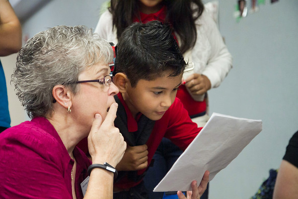 SAM HOUSEHOLDER   THE GOSHEN NEWS<br /> LaDene Nesbitt, an interventionist at West Goshen Elementary helps Brandon Gonzalez find his classroom Thursday.
