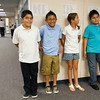 SAM HOUSEHOLDER | THE GOSHEN NEWS<br /> West Goshen Elementary fourth grade students Oswaldo Gamboa, Eduardo Gonzalez, Addison Schade and Hector Juarez stand in line with their class Thursday morning. Thursday was the first day of school and the first day for the school's new dress code, which requires polo shirts like those the students are seen wearing.