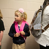 SAM HOUSEHOLDER | THE GOSHEN NEWS<br /> Raina Arbogast, a first grader, waits in line for breakfast Thursday at West Goshen Elementary School. The school had its first day of class and also introduced its new dress code, which Arbogast shows with a khaki skirt and polo shirt.