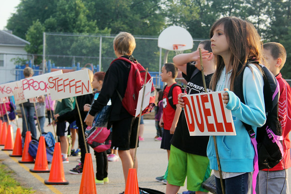 JULIE CROTHERS | THE GOSHEN NEWS<br /> Cehcily Gerardot, 8, waits in line for her first day of third grade at Parkside Elementary School. Students lined up with their classmates before entering the building Thursday morning.
