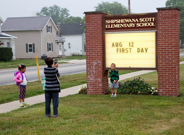 SAM HOUSEHOLDER | THE GOSHEN NEWS<br /> Christina Mullet takes a photo of her son Lucas, 5, while daughter Lilly, 6, looks on. Lucas began kindergarten and Lilly first grade at Shipshewana Scott Elementary School Tuesday.
