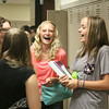 JULIE CROTHERS | THE GOSHEN NEWS<br /> Wawasee High School freshmen Morgan Jones, left, and Morgan Perry, right, share a laugh with friends before class begins Tuesday on the first day of school.