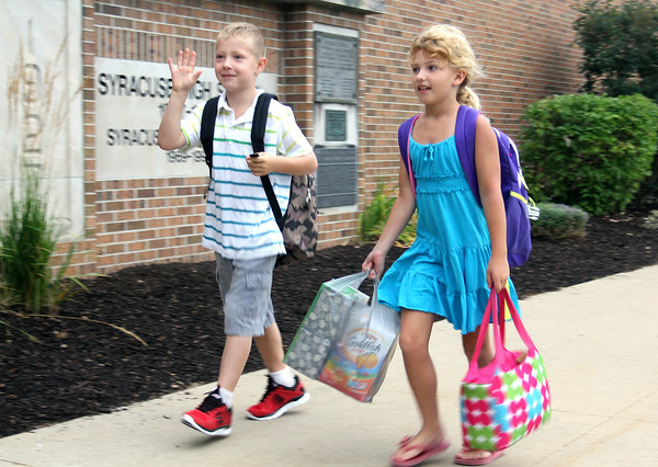 JULIE CROTHERS | THE GOSHEN NEWS<br /> Second graders Max Ponder, left, and Zoey Fields arrive at Syracuse Elementary School Tuesday for the first day of school.