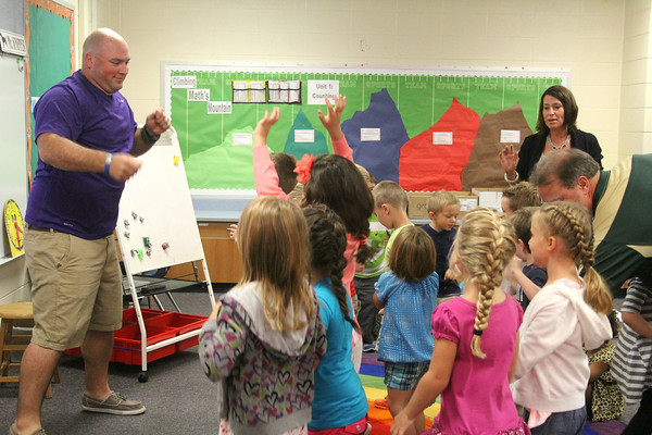 JULIE CROTHERS | THE GOSHEN NEWS<br /> Kindergarten teacher Jared Knipper leads his class in a celebratory dance on the first day of school Tuesday at Syracuse Elementary School.