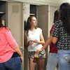 JULIE CROTHERS | THE GOSHEN NEWS<br /> Junior Tia Long visits with her Wawasee High School classmates at their lockers before the first day of school Tuesday.