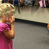 JULIE CROTHERS | THE GOSHEN NEWS<br /> Kindergartener Kaitlyn Mccreary dries her eyes after saying goodbye to her parents on the first day of school Tuesday at Syracuse Elementary School.