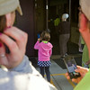 SAM HOUSEHOLDER | THE GOSHEN NEWS<br /> Jessica Darrenkamp and Todd Truex watch Layla Porter walk into Millersburg Elementary School Thursday for her first day of Kindergarten. Fairfield Community Schools began the 2014-2015 school year.