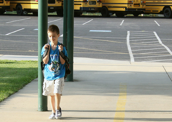 JULIE CROTHERS | THE GOSHEN NEWS Fourth grader Christopher Hochstetler was one of the first students to arrive Thursday morning at Nappanee Elementary School for the first day of school.