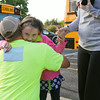 SAM HOUSEHOLDER | THE GOSHEN NEWS<br /> Layla Porter hugs her stepfather Todd Truex Thursday before her first day of kindergarten at Millersburg Elementary School. Fairfield Community Schools began the 2014-2015 school year Thursday.