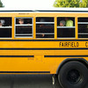 SAM HOUSEHOLDER | THE GOSHEN NEWS<br /> Students look out the window of their school bus Thursday after it dropped off Millersburg Elementary School students for the first day of school.