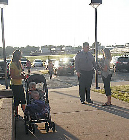 AMY WENGER | THE GOSHEN NEWS<br /> Wa-Nee Director of Curriculum Jim Bennett and Wakarusa Elementary guidance counselor Kris Fielstra chat during the final moments before the official launch of the 2014-15 school year on Thursday morning at Wakarusa Elementary School.