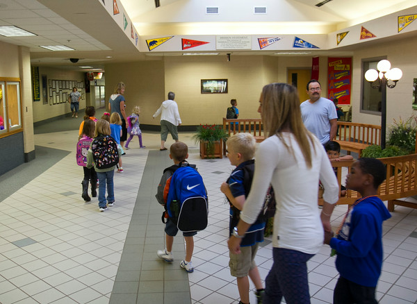 SAM HOUSEHOLDER   THE GOSHEN NEWS<br /> Kindergarteners, teachers and parents file into Jefferson Elementary School Wednesday for the first day of school. Jefferson is part of the Middlebury Community School system.
