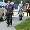 JULIE CROTHERS | THE GOSHEN NEWS<br /> The Loy family makes their way down the sidewalk Wednesday toward the first day of school at Clinton Christian School. Seventh grader Dylan Loy leads the group with younger brother Gavin, a second grader, and parents Kris and Stella Loy following behind.