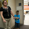 SAM HOUSEHOLDER | THE GOSHEN NEWS<br /> A kindergarten teacher at Jefferson Elementary School stands with one of her students Wednesday before ther first day of school.