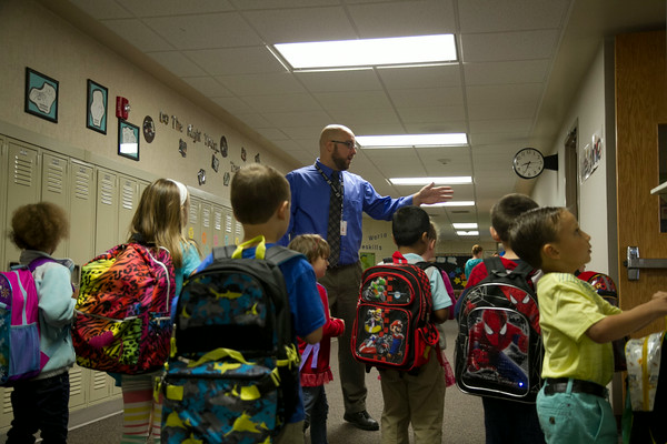 SAM HOUSEHOLDER | THE GOSHEN NEWS<br /> Ox Bow Elementary kindergarteners are herded to their classrooms by principal Kent Myers. Concord schools began Wednesday.