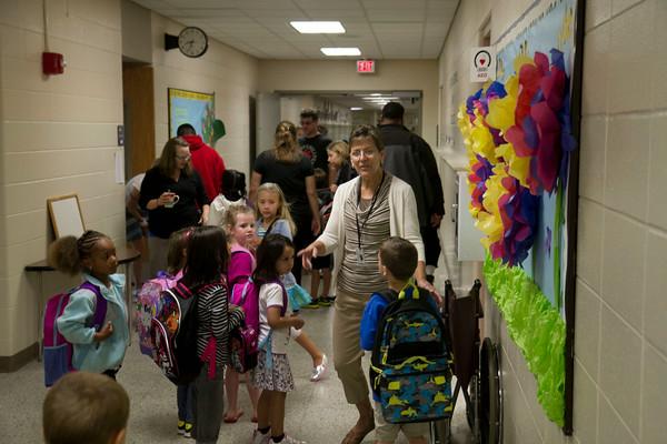 SAM HOUSEHOLDER | THE GOSHEN NEWS<br /> A teacher helps students find their classrooms Wednesday at Jefferson Elementary School.