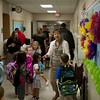 SAM HOUSEHOLDER | THE GOSHEN NEWS<br /> A teacher helps students find their classrooms Wednesday at Jefferson Elementary School.