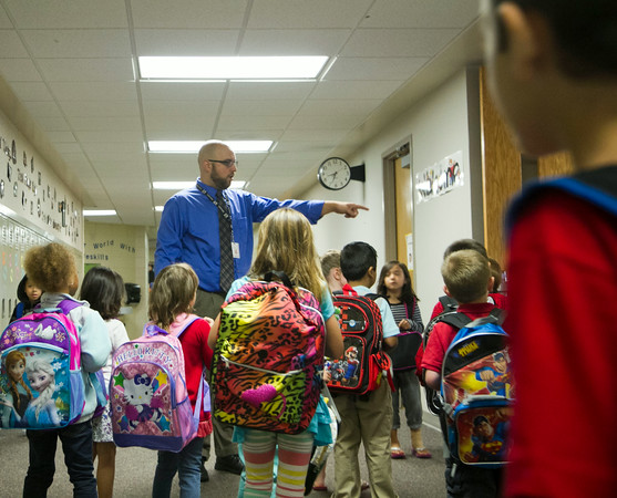 SAM HOUSEHOLDER   THE GOSHEN NEWS<br /> Ox Bow Elementary kindergarteners are herded to their classrooms by principal Kent Myers. Concord schools began Wednesday.
