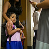 SAM HOUSEHOLDER | THE GOSHEN NEWS<br /> Tania Medina stands with relatives before her first day of Kindergarten Wednesday at Jefferson Elementary School. Middlebury Community Schools returned for the 2014-2015 school year Wednesday.
