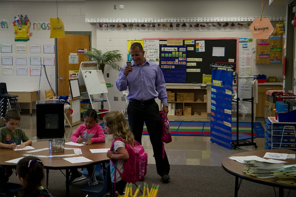 SAM HOUSEHOLDER | THE GOSHEN NEWS<br /> David Franks takes a photo of his daughter Niya in her Kindergarten classroom Wednesday at Ox Bow Elementary School.