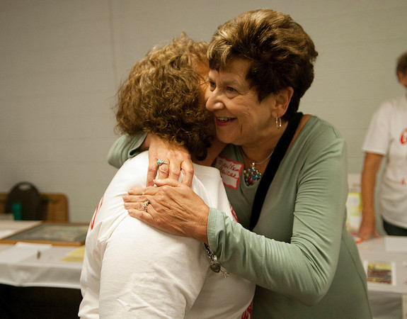 HALEY WARD | THE GOSHEN NEWS<br /> Patsy Berkey and Judy Keim Bender embrace during the Goshen High School Alumni Reunion on Sept. 1 at the Elkhart County 4-H Fairgrounds.