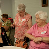 HALEY WARD | THE GOSHEN NEWS<br /> Patsy Zook Logan, Mary Jo Warstler and Bonnie Arnold catch up during the Goshen High School Alumni Reunion on Sept. 1 at the Elkhart County 4-H Fairgrounds.