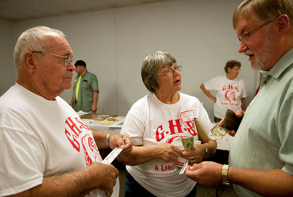 HALEY WARD | THE GOSHEN NEWS<br /> Sid Slabaugh, class of 1967, (right) buys a 50/50 raffle ticket from Rosalie Snyder Rock and Bob Rock during the Goshen High School Alumni Reunion on Sept. 1 at the Elkhart County 4-H Fairgrounds.