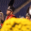 NorthWood senior Dylon Price takes a breath during the band's performance.