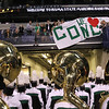 Concord band parents hold up signs and cheer for the band as they exit the field after placing fourth at the state band finals.