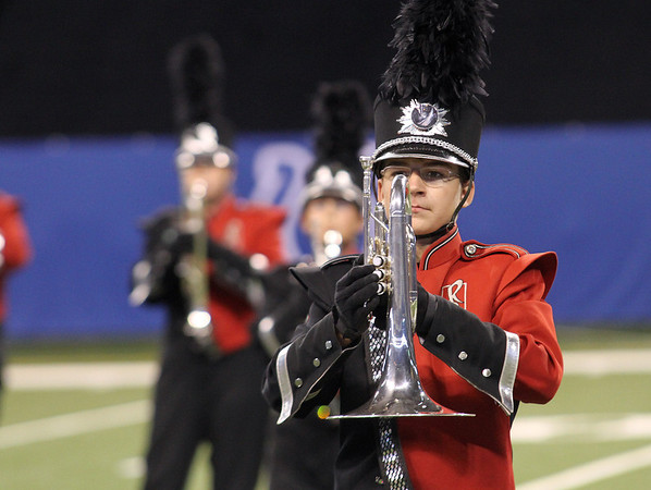NorthWood senior Kevin Schrock marches with the rest of the Red Regiment during the State Band Finals.