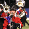 Goshen sophomore Corey Mack plays with the Goshen Marching Crimson Band Saturday during the state band finals.