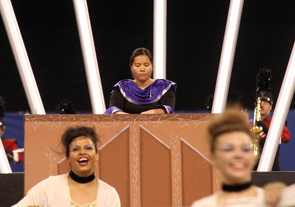 Goshen sophomore Michelle Holcombe plays synthesizer with the Marching Crimson.