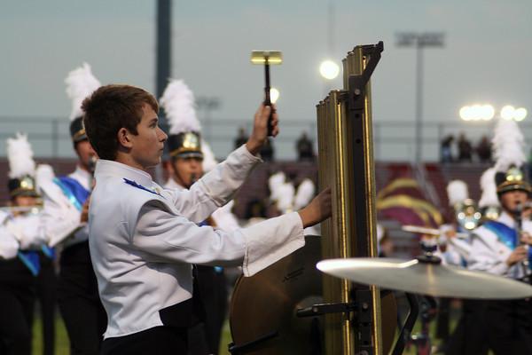 Jennifer Meier   The Goshen News<br />  Wyatt Tiffany, a freshman, plays the chimes for the Northridge Raiders band Saturday.
