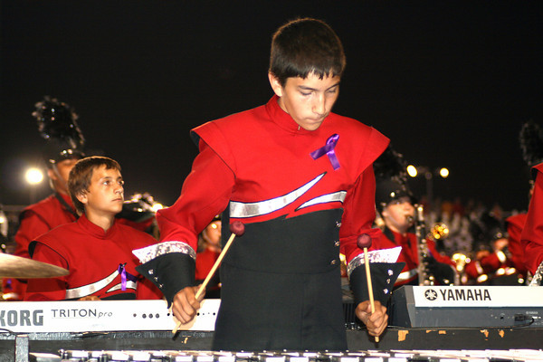 Jenniefer Meier } The Goshen News<br /> Octavio Blacutt, a freshman percussionist, taps out a tune on the xylophone during the bands show at Elkhart Memorial High School.