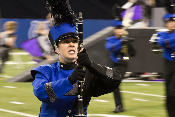 SAM HOUSEHOLDER | THE GOSHEN NEWS<br /> Fairfield junior Halley Neilson moves during the band's performance at the ISSMA State Marching Band Finals in Indianapolis Saturday.