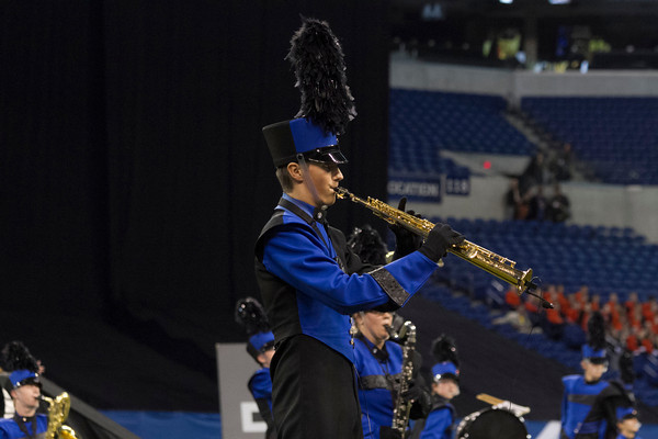 SAM HOUSEHOLDER | THE GOSHEN NEWS<br /> Fairfield junior Tyler Koss plays the soprano saxophone during the ISSMA State Marching Band Finals in Indianapolis Saturday.