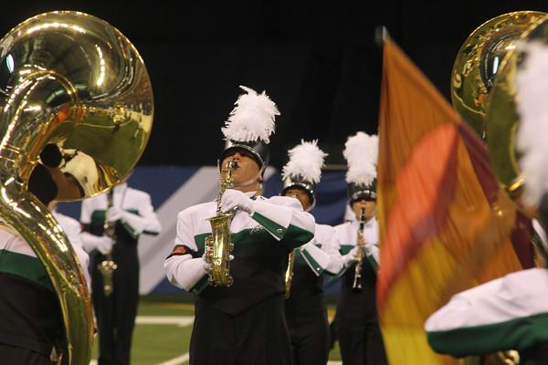 SAM HOUSEHOLDER | THE GOSHEN NEWS<br /> Concord senior Sam Quist plays saxophone during the Concord Marching Minutemen's performance Saturday.