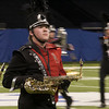 SAM HOUSEHOLDER | THE GOSHEN NEWS<br /> NorthWood saxophone player Aron Patterson moves during the Red Regiment's ISSMA State Marching Band Finals performance in Indianapolis Saturday.